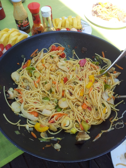 Chinese wok meal with courgettes, leek, carrots, baby bell mushrooms, peas, cauliflower, bell peppers noodels and chinese spices. Flavoured with soy sauce