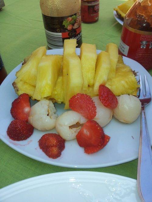 Fresh pineapple and strawberries accompanied by sweet lychees