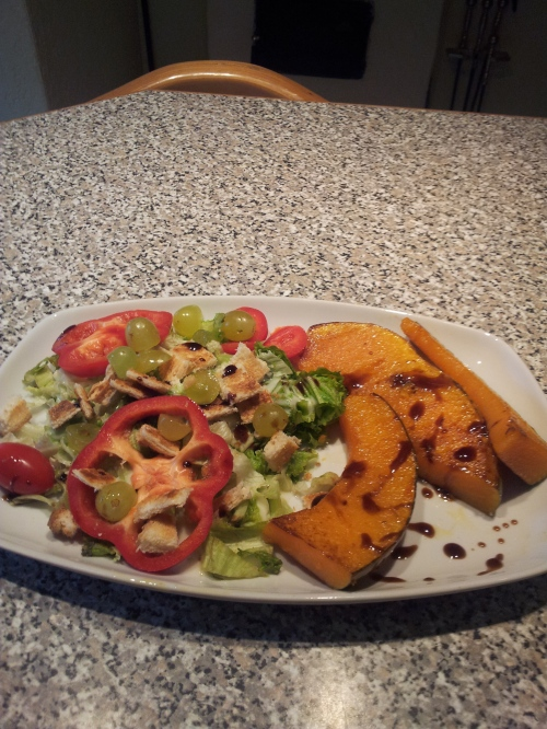 Salad with croutons, grapes, grilled pumpkin slices  and a drizzle of balsamic vinegar